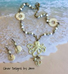 August Challenge .. Ivory Ice Resin was used on all of the stampings .. A B'sue Octopus is attached to a chain that is made with mother of pearl beads, white and crackle glass beads, brass chain .. dangling under the octopus are a B'sue anchor, starfish and a crackle bead  .. matching earrings also have a B'sue Anchor .. Clever Designs by Jann https://www.etsy.com/shop/CleverDesignsbyJann