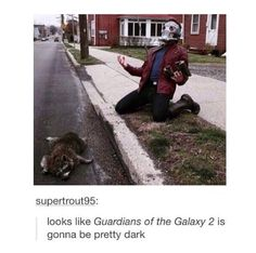 I think the best part is that somebody saw a dead raccoon, went home, dressed in full Star Lord costume, brought along his weapon, brought along a friend, went back and posed for this picture.