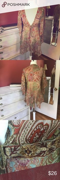 Sharon Young. Beautiful Boho top Great piece!  Can be worn over a cami dressed up or down.   I loved it with jeans and heels. Size 6 Polyester. Beautiful beaded trim.  This has always been a complement magnet for me. Sharon Young Tops