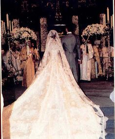 A view of the back of Crown Princess Marie-Chantal's wedding gown. With a magnificent 15 foot train and full length chantilly lace veil, the gown is thought to be one of the most expensive wedding gowns ever produced at a cost of $ 240,000.00
