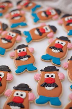 """Potato Head Cookies for a Birthday Party These fabulous ideas will take your Toy Story birthday party to infinity and beyond! There may be no """"snake in [your] boots"""", but these 21 Toy Story themed birthday party ideas will add pep to Fête Toy Story, Toy Story Baby, Toy Story Theme, Toy Story Food, Toy Story Cupcakes, Toy Story Cookies, Toy Story Birthday Cake, Birthday Cookies, Bolos Toy Story"""