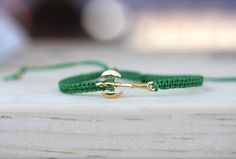 Arm Candy Friendship Bracelet. 18k Gold Double Headed Axe & Silk Band