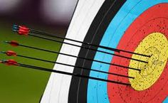 Getting a bullseye in archery.