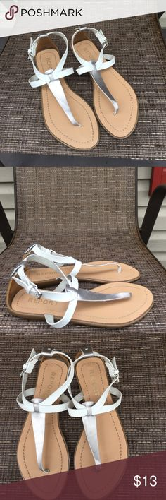 Report women's t-strap silver/ white sandals Nice women's sandals, faux leather upper, t -strap and adjustable ankle strap, tan synthetic heel and bottom. EUC Report Shoes Sandals