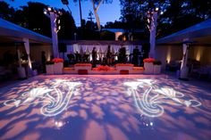 Tented corporate event decor, love the lighting!