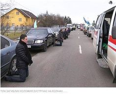 As column of vehicles with the bodies of the fallen Ukrainian Soldiers are brought home, Ukrainians fall on their knees in honor and respect of their sacrifice. (Kolomiya, Ukraine. Spring 2015)