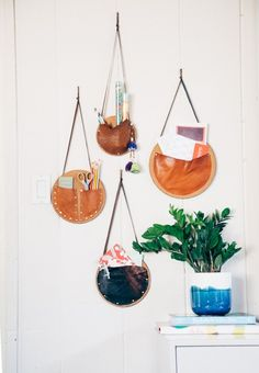 diy hanging leather catch-all baskets. good for storing crafting items.