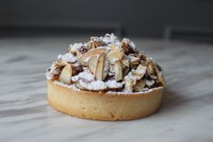 Apple Gratin Tart : Tart shell with vanilla bean pastry cream caramelized apples and roasted almonds