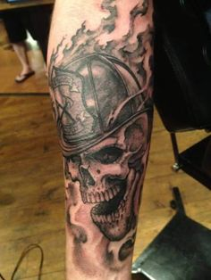 Black And Grey Firefighter Skull Tattoo Design For Sleeve