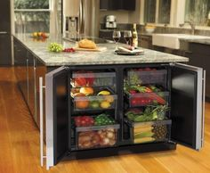 Kitchen island of enormous size with many built-in cupboards for fruits and vegetables The post The modern cooking island in the kitchen & 20 amazing ideas for kitchen design appeared first on Suggestions. Clever Kitchen Ideas, Smart Kitchen, New Kitchen, Kitchen Storage, Kitchen Dining, Island Kitchen, Kitchen Organization, Organization Ideas, Fridge Storage