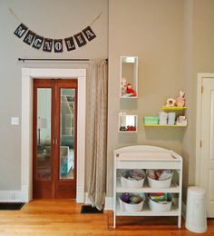 Love the name banner.  Now to get 'someone' to add on an extra bedroom for the baby.