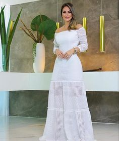 Image may contain: 1 person, standing Dress Outfits, Fashion Dresses, Crochet Wedding Dresses, Flower Skirt, Teen Girl Outfits, Indian Designer Outfits, Fashion Line, Women's Fashion, African Dress