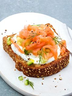 Quark Toast with salmon, fresh herbs, cucumber, and cracked pepper!