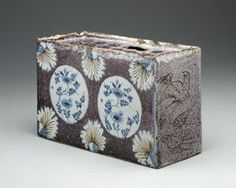 Flower-holder (flower-brick); tin-glazed earthenware; sides decorated with two circular panels; flowers and six palmettes in blue on mangane c.1750...