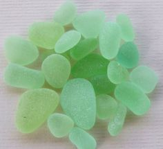 """UV Lime Green (""""Vaseline Glass"""") is one of the most unusual types of sea glass a beach comber might come across. To the naked eye, it is a soft lime green... and might easily be lumped together with Pastel Green, or even Seafoam sea glass. However, it often has what almost seems like an """"inner luminescence"""" to it, somehow brighter than other pale greens."""