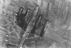 A B-17E Flying Fortress in a spin with one wing destroyed. In instances like this it is very unlikely that the crew got out due to the centrifugal forces involved. This type of aircraft had a crew of 10.