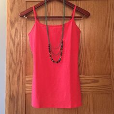 express coral Cami with built in bra NWOT bright coral Cami. Perfect for summer! Wear solo with white shorts or under a lace shirt. Nice basic for color lovers. Express Tops Camisoles