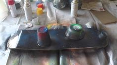How to art spray paint planets on a used skateboard