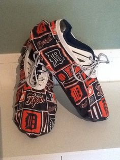 "Custom Bowling Shoe Covers are handmade from the materials described. The vinyl will be a corresponding color to the fabric. • 1 pair (2 covers) • Fabric 100% polyester (top), with 1"" fold-over elastic  **pattern layout maybe different than picture due to the patchwork pattern of the material and the size ordered. There will always be the tigers logo on the toe top**  Marine Vinyl Bottom o 100% PVC Face /100% Polyester Backing o Wipe with Damp Cloth o Made in Columbia  Protects bowling ..."