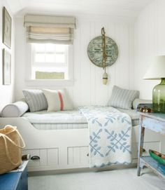 "This former pantry in this Nantucket cottage morphed into the ""Ship's Room,"" where a built-in berth beckons guests to curl up with a good book. A wooden barrel top and a nautical buoy combine to make timeworn wall art."
