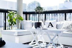 Simple yet stylish modern balcony styling - black and white theme