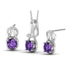 Latest designer tanzanite color earrings and pendant set for women. Buy now: www.glimmering.co.in