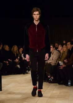 The Sneakers in black and military red, worn with a raglan sleeved bomber jacket