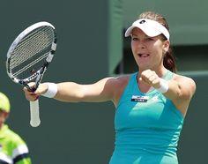 Radwanska celebrates defeating Sharapova to win Sony Ericsson Open.
