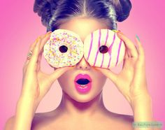 Beauty model girl taking colorful donuts. Dieting concept by Subbotina. Beauty model girl taking colorful donuts.