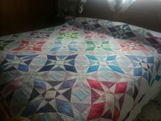 Dawn's Stormy Seas Star quilt,  the quilting is done;  Now Mom just needs to do the binding.