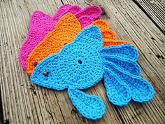 Crochet a school of Fancy Goldfish coasters for your tables with my complete and easy to follow instructions! Finished coaster measures approximately 8 by 7 1/2 inches at its widest points. Pattern comes with complete assembly instructions including photos to help you along.