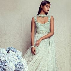 A reverie in a pastel crescendo of embroidery & embellishment - Tarun Tahiliani Couture.  Check out the collection on TarunTahiliani.com & tell us what you think in the comments below!  #taruntahiliani #pastel #blue #embellish #indian #couture #india #designer #fashion #luxury