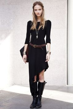 Black dress with tall, black boots and brown belt.