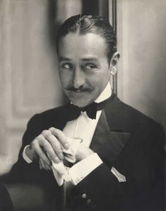 "Adolphe Menjou - started out occasionally, in silent movies, with a few leading roles, but nearly all of his career decades) was spent in supporting and secondary roles. This photo is from ''A Woman of Paris"", a silent film in 1923 Hooray For Hollywood, Golden Age Of Hollywood, Vintage Hollywood, Hollywood Stars, Classic Hollywood, Hollywood Glamour, Edward Steichen, Ascot Ties, Alfred Stieglitz"
