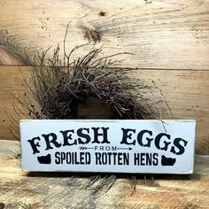 "This sign is made from pine, and measures Approx 5.5 H x 18""L. It reads ""Fresh Eggs From Spoiled Rotten Hens"". The front is painted a tan/grey color then distre"