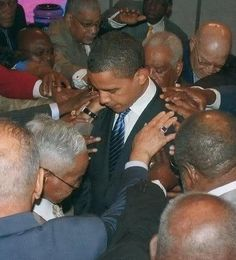 "...more like a photo that inspires me...several african american men praying ""over"" Barack Obama..."