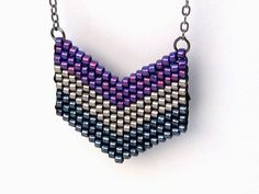 Beaded Chevron Necklace, Purple and Black and Silver Necklace, Silver Chevron Necklace, Geometric Necklace, Seed Bead Pendant by MiaWinkJewelry on Etsy https://www.etsy.com/listing/218109759/beaded-chevron-necklace-purple-and-black