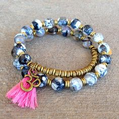 27 bead mala wrap bracelet, made with faceted black strip agate, with a pink tassel, and an Om charm. (cut tassel out with scissors when it wears off, and keep our sturdy, flawlessly constructed brace