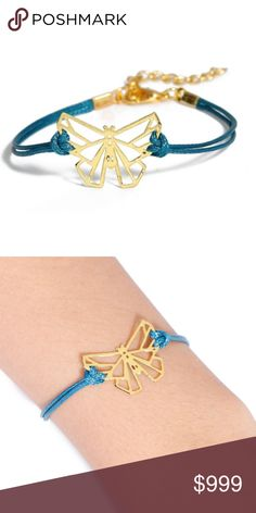 """COMING SOON!! Butterfly Origami Charm Bracelet COMING SOON!! """"Like"""" To Be Notified!!   Brand new in original packaging. Gold hollow origami butterfly charm royal blue/teal double cord bracelet. Made of rope chain (7.3in + extender for adjustable length) & gold electroplated metal, nickel & lead free.  All sales are final, please ask all questions prior to purchasing! Jewelry Bracelets"""