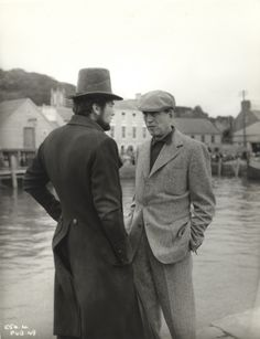 "John Huston and Gregory Peck on the set of ""Moby Dick"" (1956). Director: John Huston."
