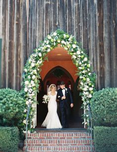 Arched entryway covered in flowers