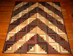Chevron Log Cabin Quilt by dawnasfolkart, via Flickr  This setting is very unique.