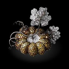 Michelle Ong. Midnight Pumpkin.  White, Fancy Intense Yellow Diamond brooch set in Platinum and18K Yellow Gold.