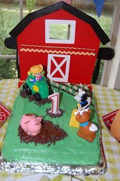 Super easy barnyard cake.  Sheet cake + green icing + Little Tikes farm animals!