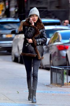 Le Fashion Blog Alexa Chung Beanie Hat Shearling Jacket Black Skinny Jeans Heeled Boots Via Vogue