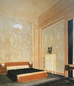 the 1925 Paris Exposition - The refined elegance of a Ruhlmann interior is seen in the bedroom in his Hotel du Collectionneur. Its walls were hung with ivory damask, the dressing table was veneered in amboyna, its top inlaid with shagreen and ivory, and the wall lamp has a fan-shaped shade of alabaster.