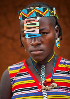 The Daasanach tribe in the Omo Valley in Ethiopia are the definition of thrifty and make beautiful pieces of jewellery and stunning headdresses out of unwanted watches and bottle caps. These stunning photographs were taken by French photographer, Eric Lafforgue, who travels the world capturing the portraits and landscapes of some of the most unique tribes...