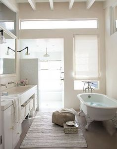 I like the layout, the shared wide sink, the faucets coming out of wall, the windows in shower, the slide out bins under sink for towel storage and the walkway down middle
