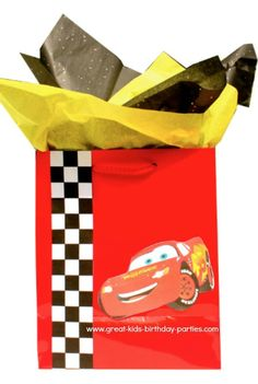 Disney Cars Party Favors - To decorate your party favors, use checkered pattern duct tape or download checkered pattern. Find your child's favorite Disney Cars photo on google search, print, cut out and paste. The bag below was made with the same checkered strip and Lightning McQueen cutout. X