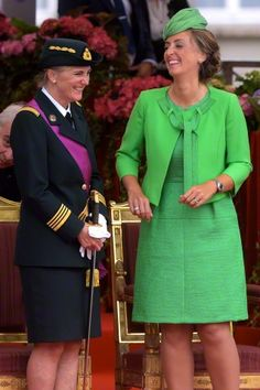 (L-R) Princess Astrid of Belgium and her sister in law Princess Claire of Belgium attends the military parade on the Belgian National Day on July 21, 2015 in Brussels.